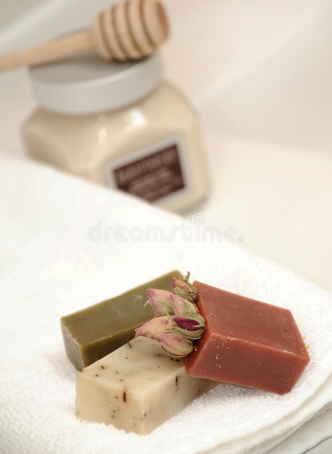 Soaps. Selectivly focussed close up of fine hand made soaps on towl in bathroom stock images