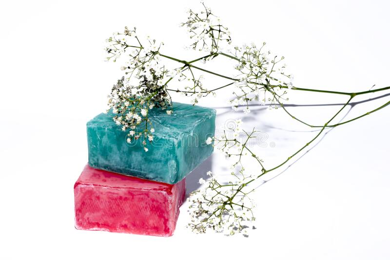 Two soaps and little white flowers stock photo