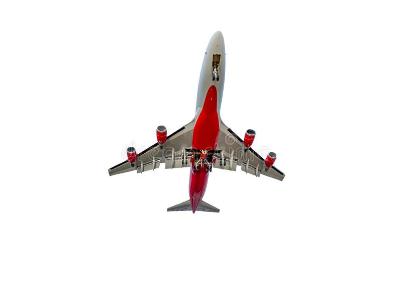 Sob do avião comercial que voa completamente no fundo branco fotos de stock royalty free