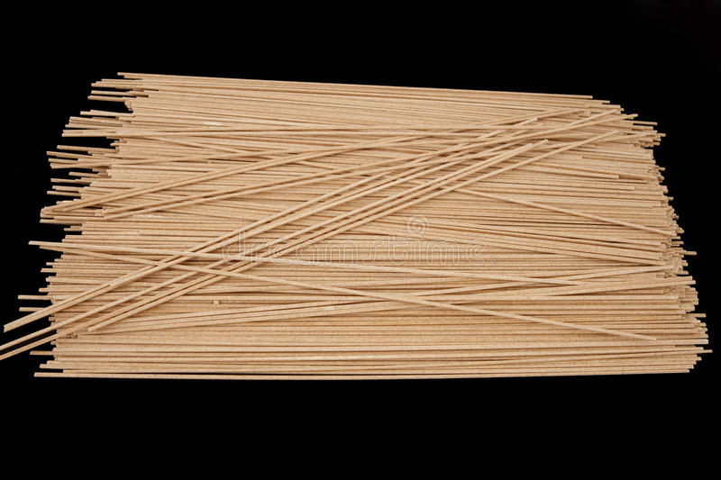 Soba noodles isolated on black royalty free stock images