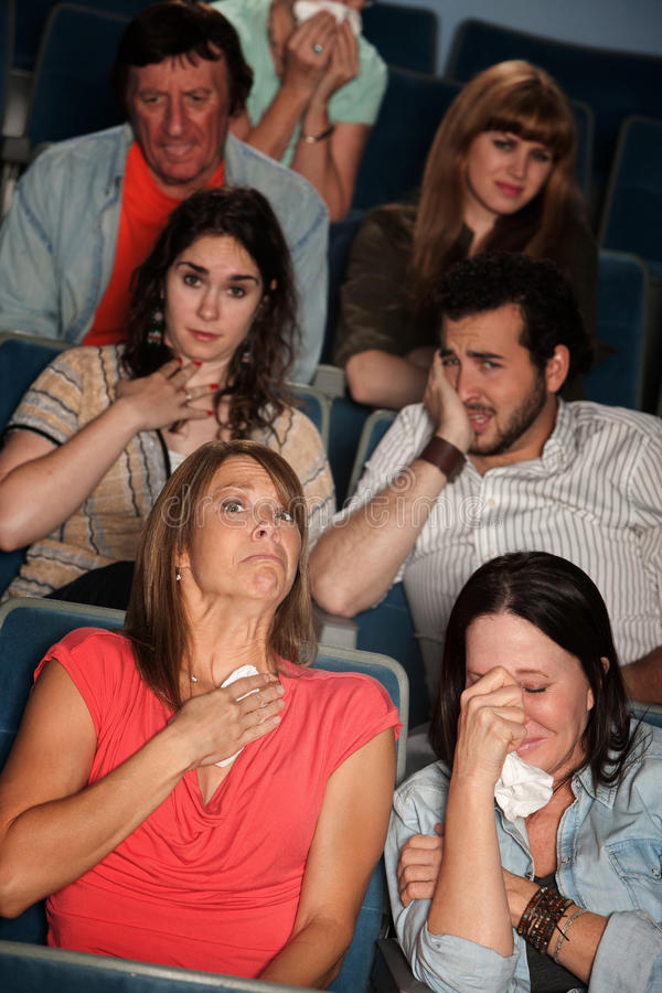 Sobbing People. Group of 7 emotional male and female spectators weep royalty free stock photos
