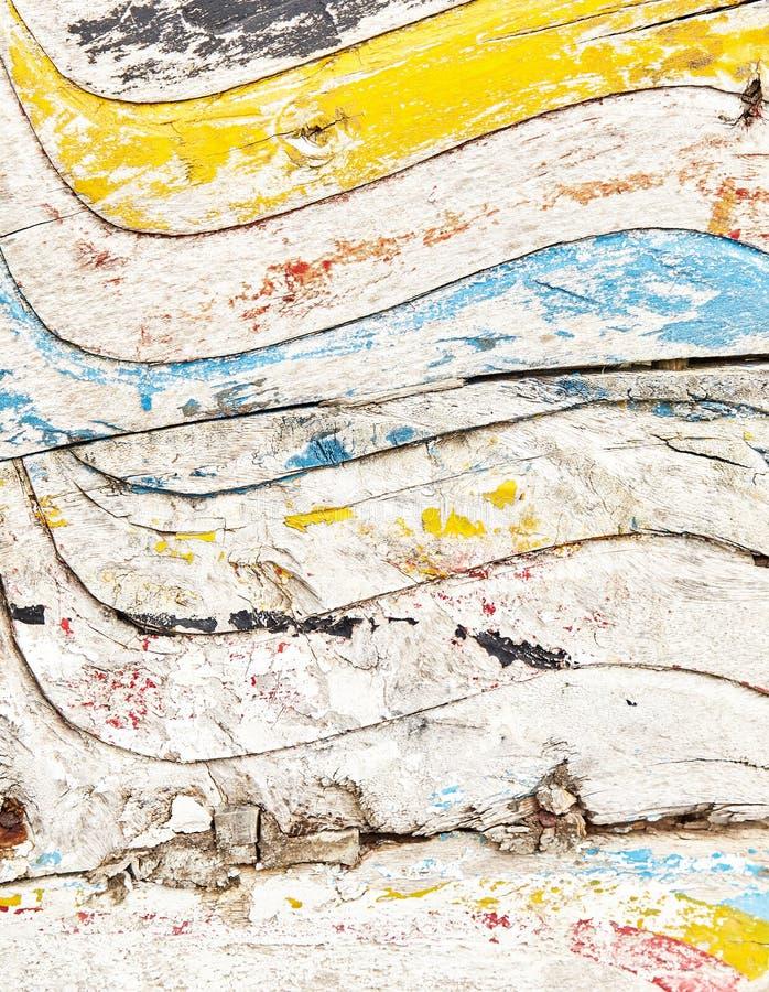 Sobras da pintura velha na superfície de madeira imagens de stock