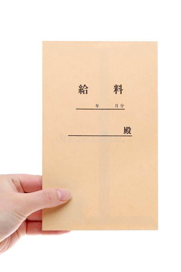 Sobre japonés del sueldo del control de la mano imagenes de archivo
