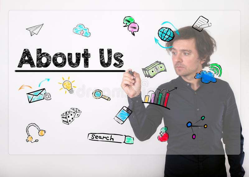 Sobre nós conceito Escrita do homem de negócios com o marcador preto no visua imagens de stock