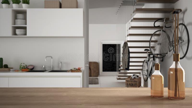Sobremesa o estante de madera con las botellas aromáticas de los palillos sobre cocina y sala de estar modernas borrosas con las  stock de ilustración
