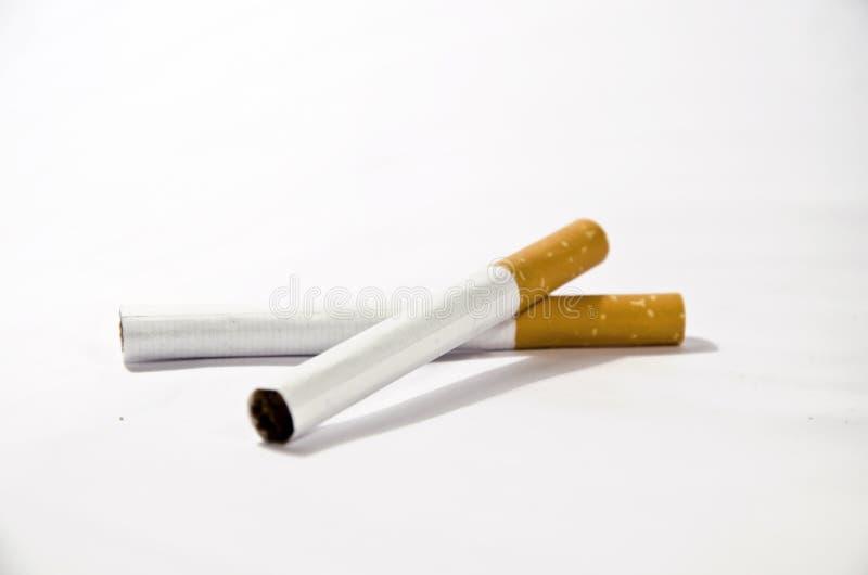 Sobreposição de dois cigarros imagem de stock royalty free