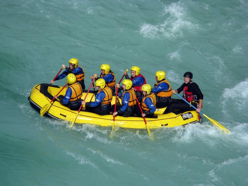 Soca rafting. A group of tourist rowing on an inflatable raft during a rafting excursion over the Soca river (Bovec, Slovenia stock photography