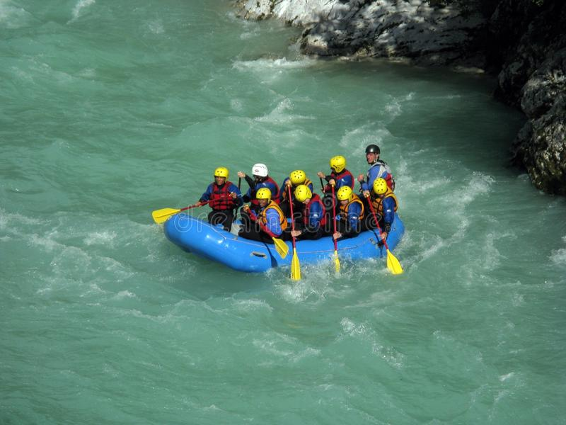 Soca rafting. A group of tourist rowing on an inflatable raft during a rafting excursion over the Soca river (Bovec, Slovenia stock image