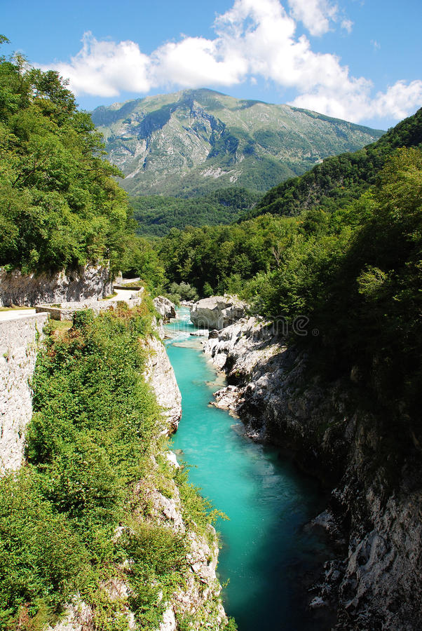 Soca River Near Kobarid 2. The River Soca, which runs through SLovenia and Italy (where it is known as the Isonzo), flowing through the alpine landscape near the stock image