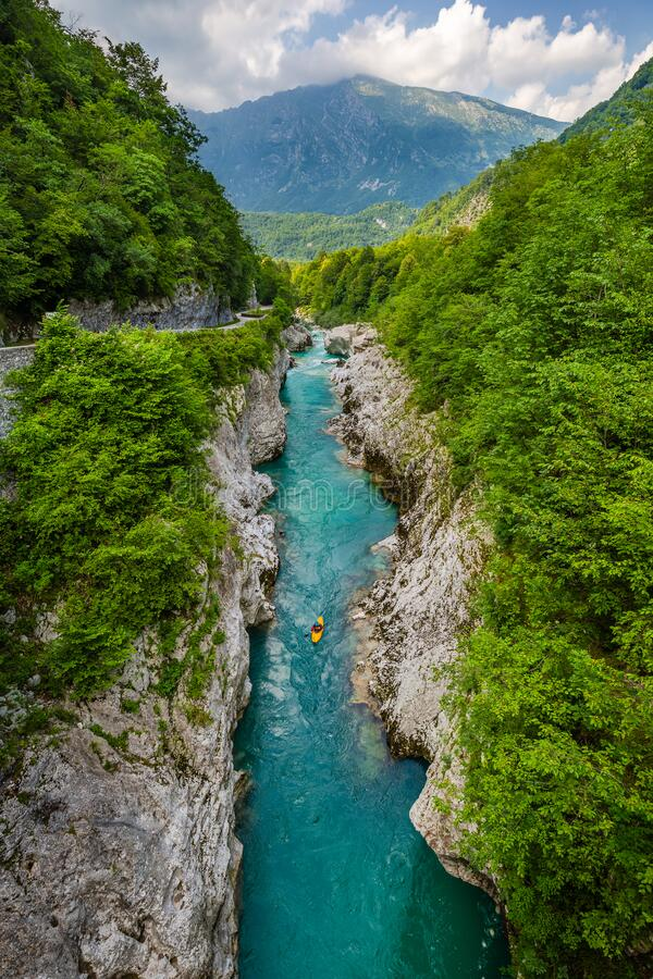Free Soca Valley, Slovenia - River Soca With Kayaker. Beautiful Turquoise Water River In The Slovenian Alps Located At Town Of Kobarid Stock Image - 213951561