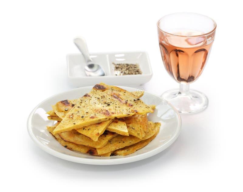 Socca, farinata, Kichererbsenpfannkuchen lizenzfreies stockbild