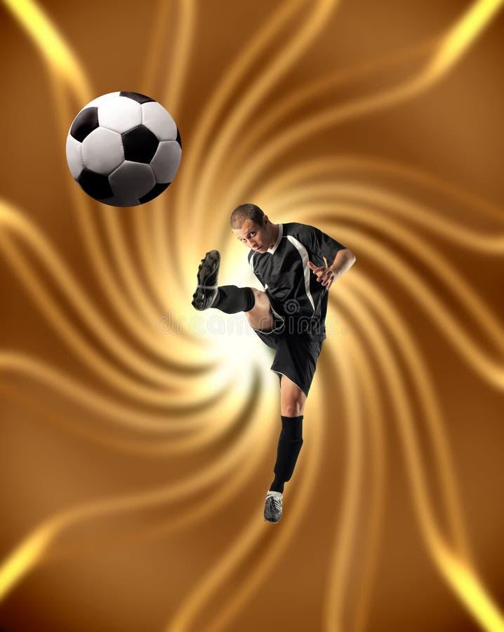 Soccer. Or football player kicking a ball royalty free stock photo