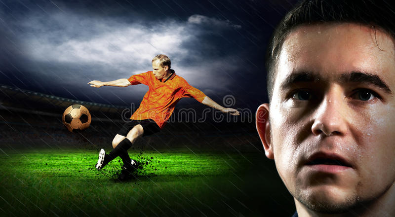 Soccer. Portrait of Soccer player on the field in night rain stock image