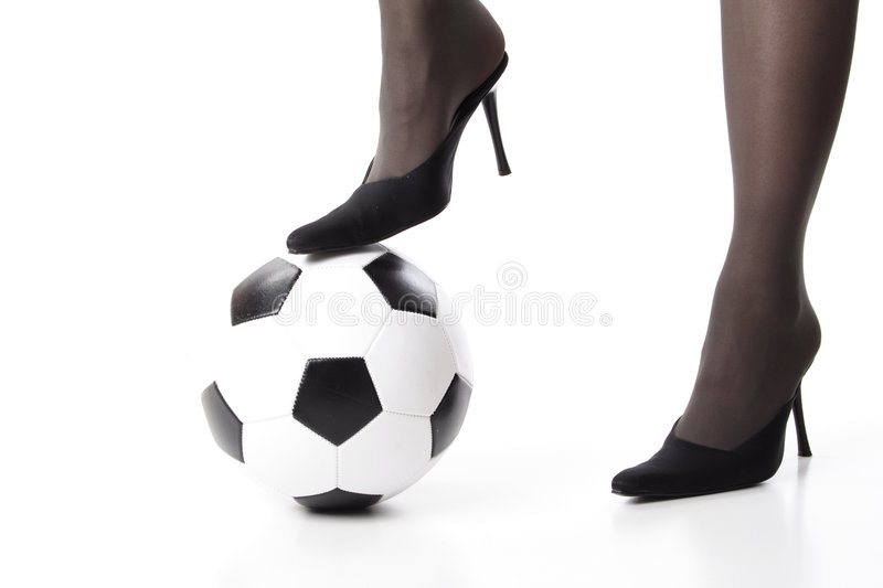 Soccer. Woman legs with ball stock photos