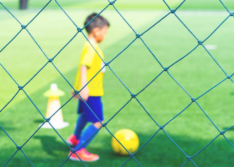 Soccer Academy for children training blurred for background stock image