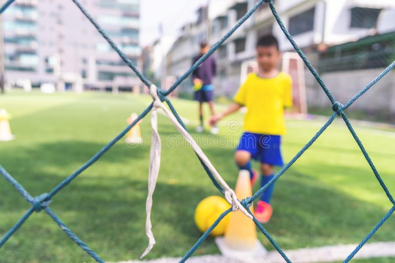 Soccer Academy for children training blurred for background stock photography