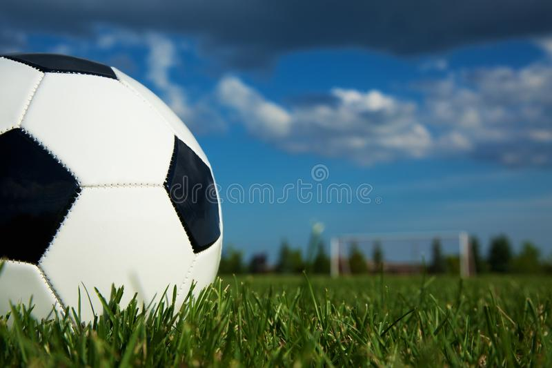 Soccer Ball. Lying on a Grass on a Soccer Field royalty free stock image