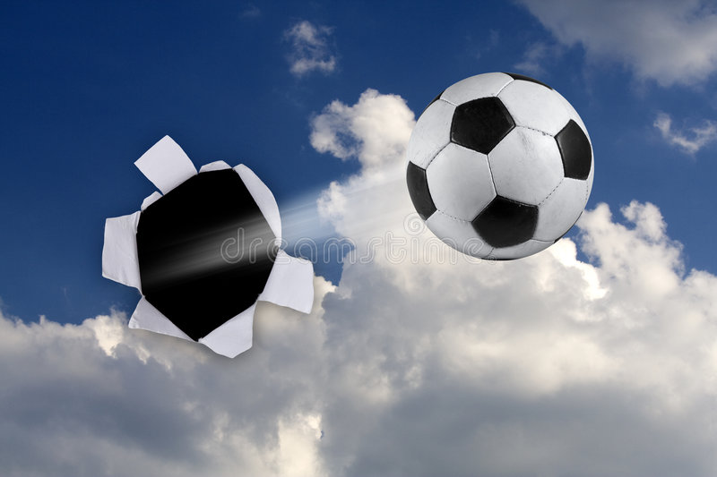 Soccer ball. Done hole in clouds stock image
