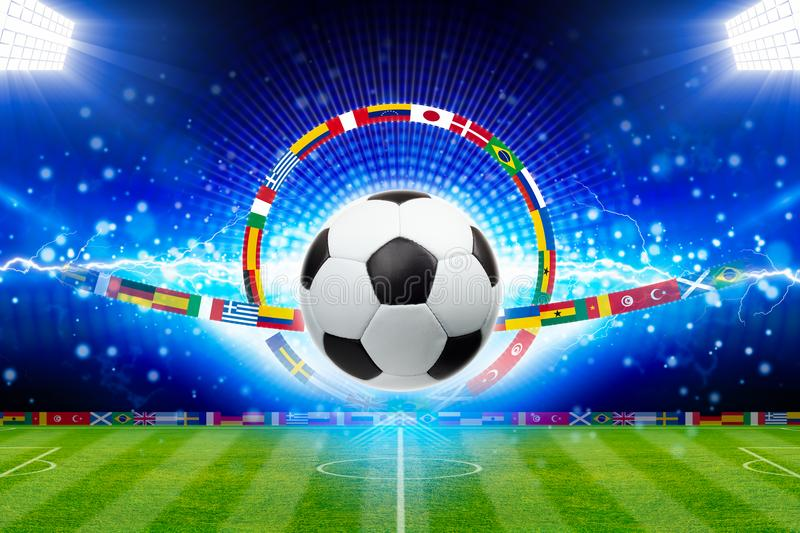 Soccer ball above green stadium with bright spotlights, main sporting event of year stock photography