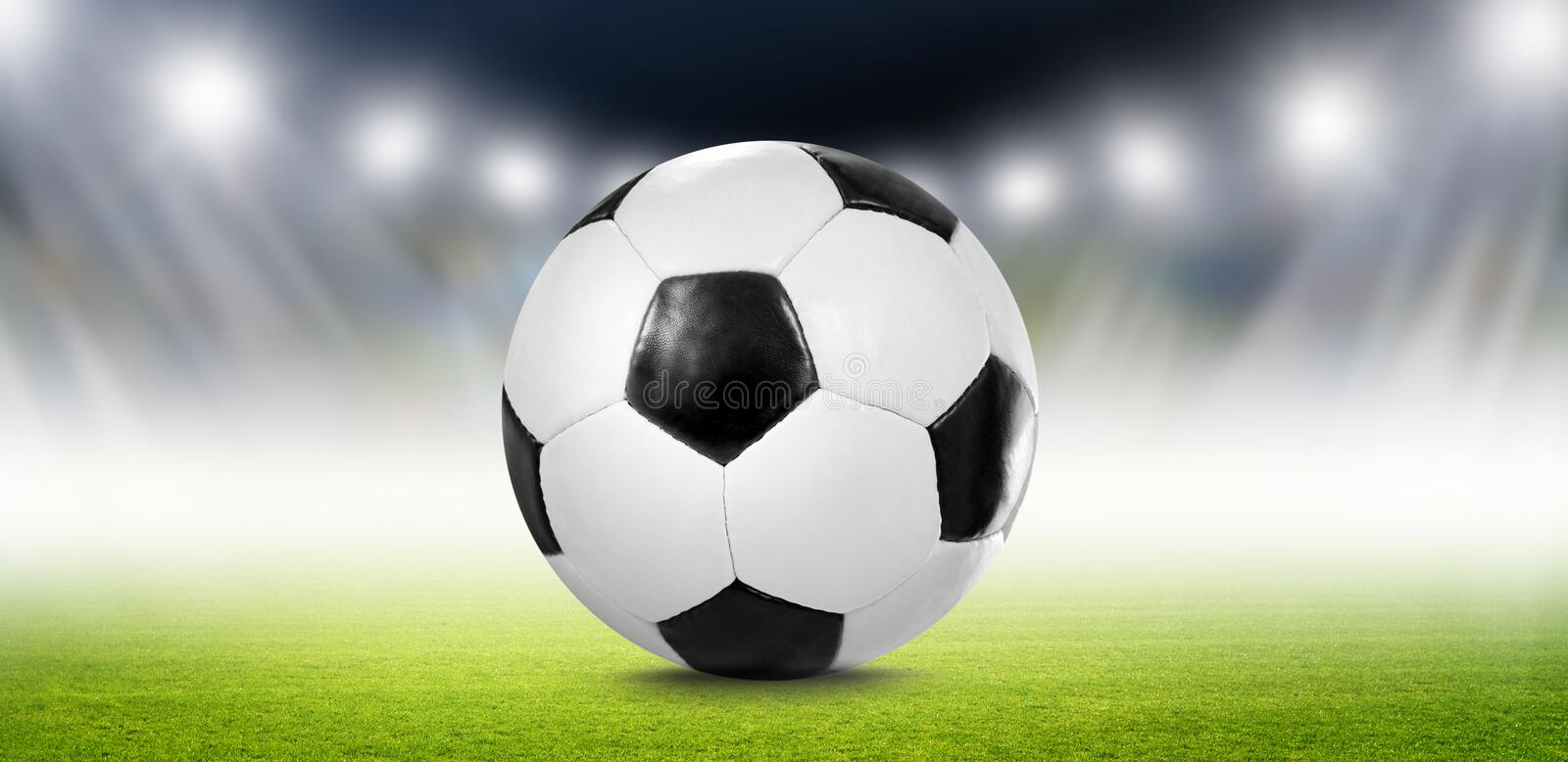 Soccer Ball in Arena. Soccer Spotlight in a Arena on Green Grass stock photo