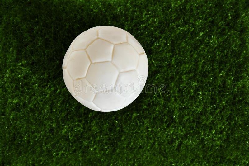 Soccer Ball on artificial grass, Dark green. with clipping path. Have a blank space for text input royalty free stock image