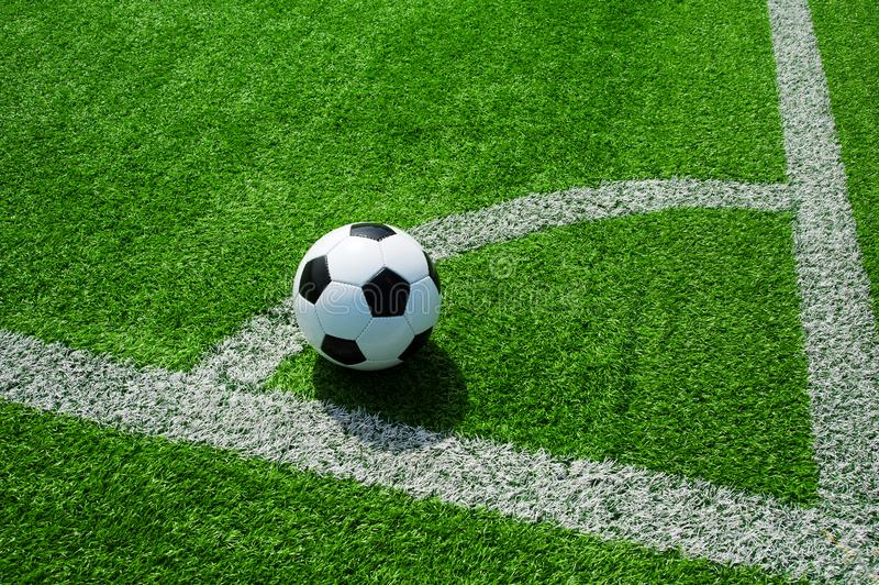 Soccer, football, ball, on corner spot, white marks, classic black and white on clean green field, space for text, good for banner stock images