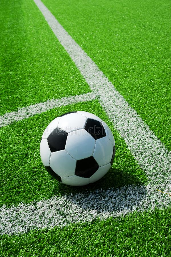 Soccer, football, ball, on corner spot, white marks, classic black and white on clean green field, space for text, good for banner. Soccer ball black and white stock photos