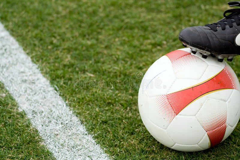 Soccer Ball And A Boot Stock Images
