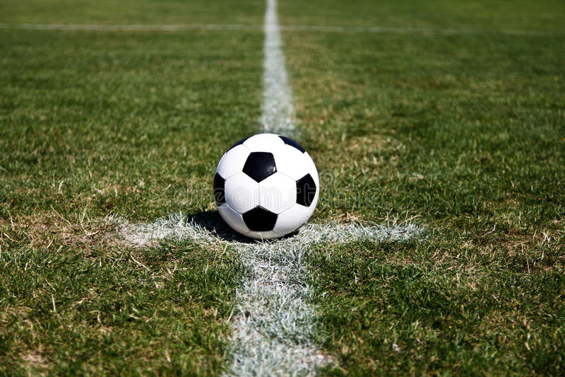 Soccer Ball On Center. Photo Of A Soccer Ball On The Centre Point Of The Stadium royalty free stock images