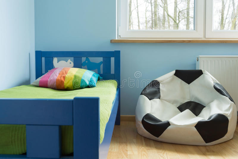 Soccer ball chair. Chair like a soccer ball in cute stylish children room royalty free stock photo