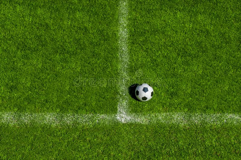 Soccer ball classic in black and white on penalty spot on green artificial turf.  royalty free stock photo