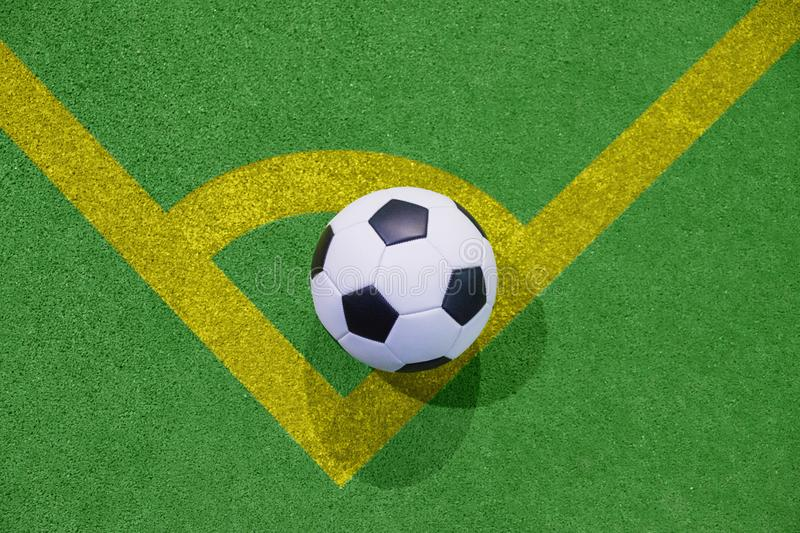 Soccer ball on a corner kick line on an artificial green grass top view royalty free illustration