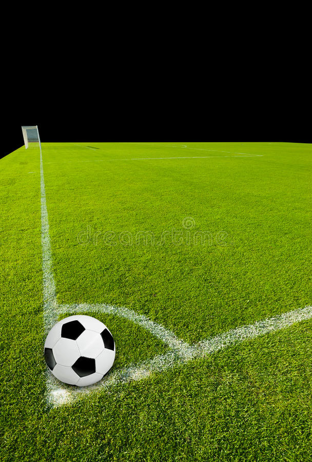 Soccer Ball on Corner Point. And tha goal on black royalty free stock photography