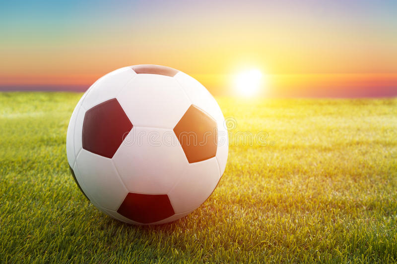 Soccer ball on the field. With sunset stock photos