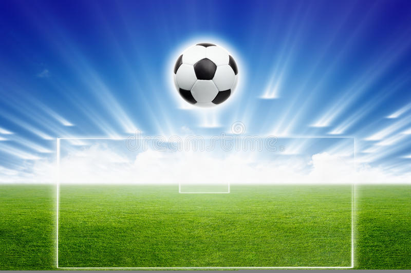 Soccer ball, field, light. Abstract sports background - green soccer stadium, soccer ball, blue sky with spotlights royalty free stock photos