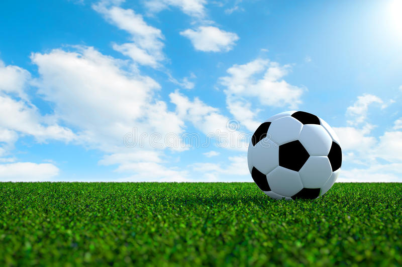 Soccer Football On Green Field With Blue Sky Background: Soccer Ball On Field With Sky Background Stock Photo