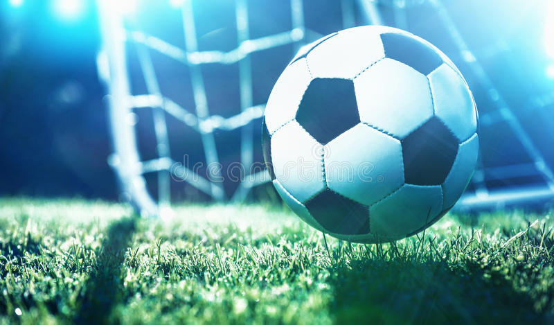 Soccer ball on the field of stadium royalty free stock image