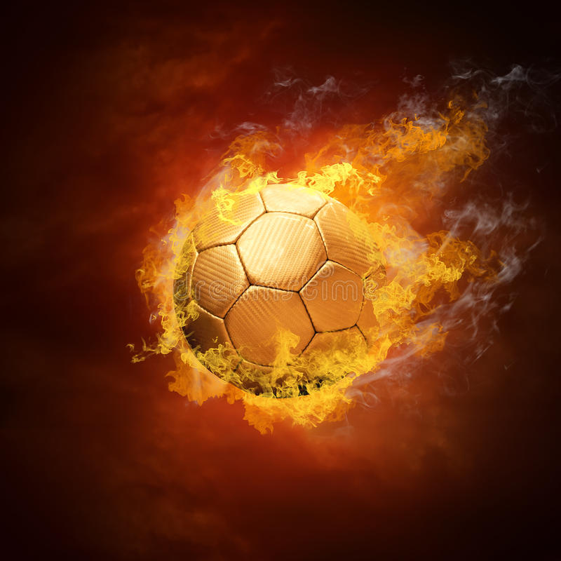 Soccer ball and fire stock image
