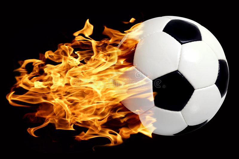 Soccer ball in flames. An image of a leather soccer ball in flames soaring through the air stock photo