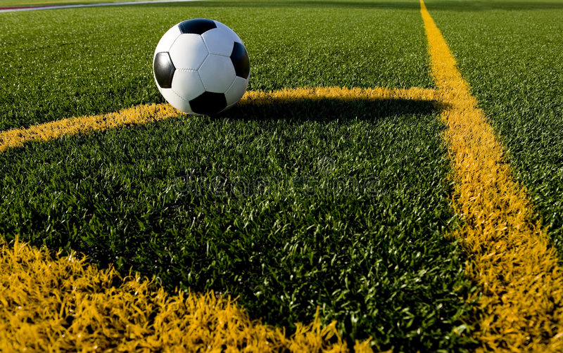 Soccer ball and football on a field royalty free stock photos