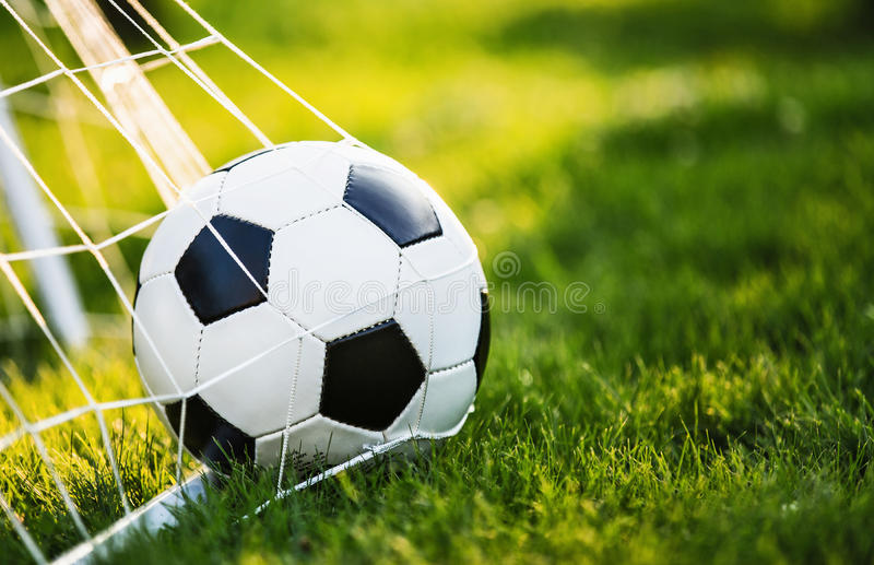 Soccer ball in goal stock images