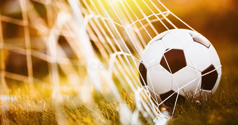 Soccer ball in goal royalty free stock photography