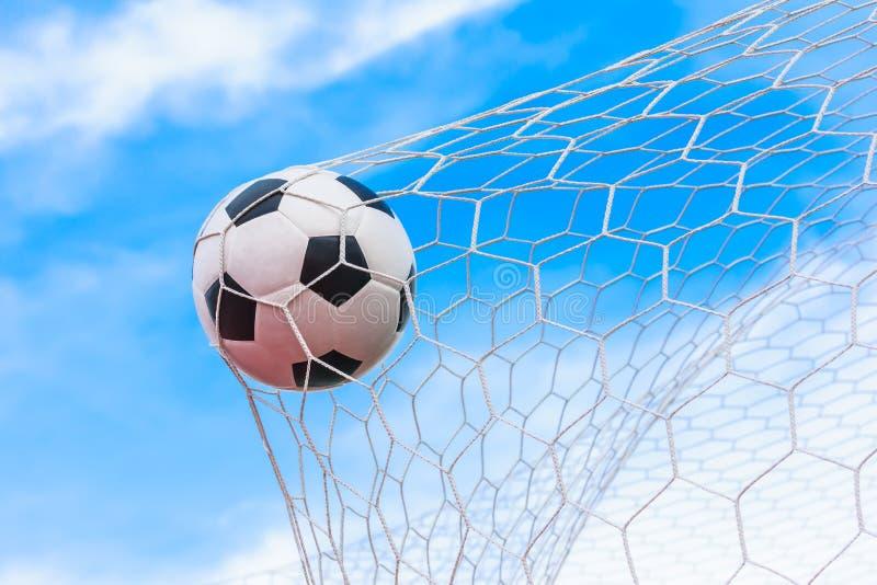 Soccer ball in goal net. Soccer ball or football in goal net royalty free stock photo