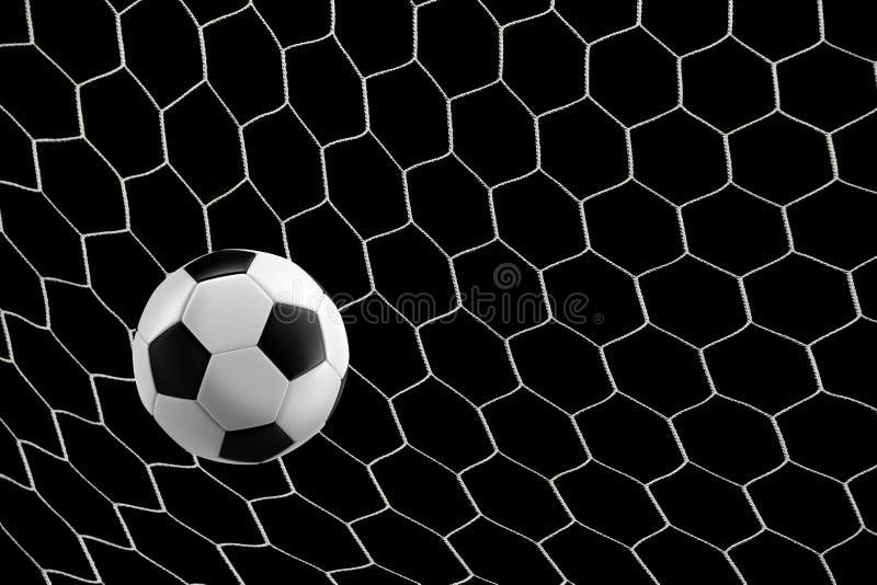 Soccer ball in goal net royalty free stock images