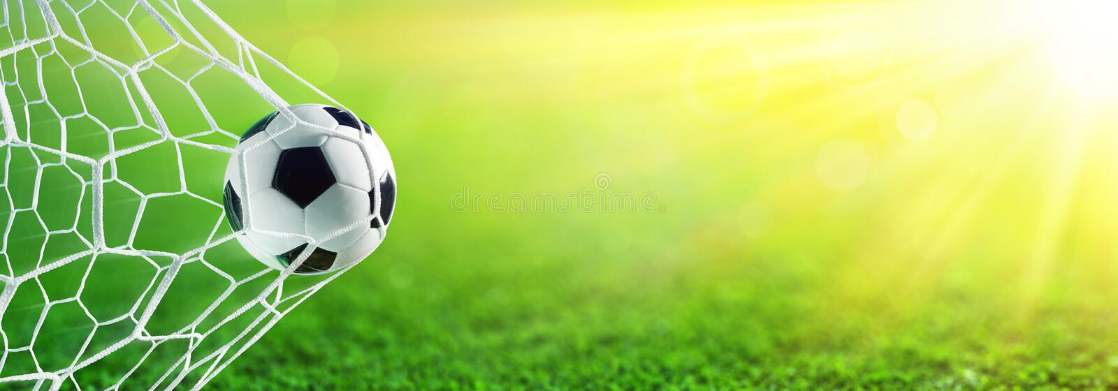 Soccer Ball In Goal. With Sunlight stock photos