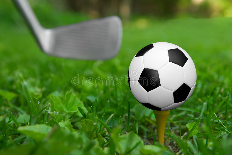 Soccer ball on golf tee stock images