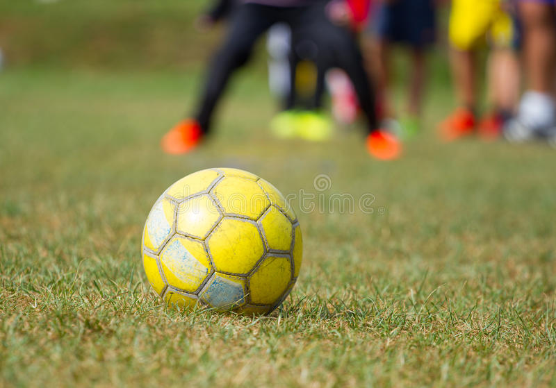 Soccer ball on the grass. And training children stock images