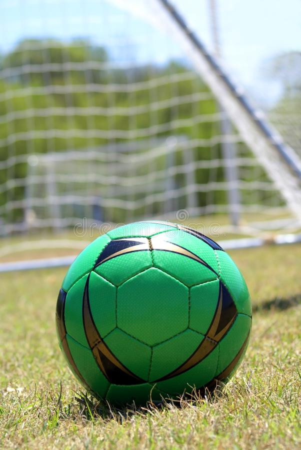 Soccer ball in green royalty free stock photos