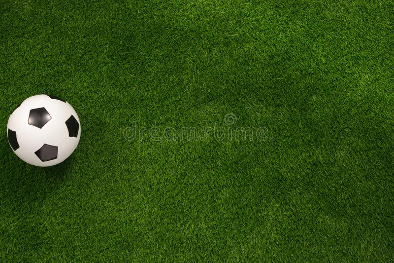 Soccer ball on the green field. View from above. flat lay.Copy space. Soccer ball on the green field. View from above. flat lay The concept of football matches royalty free stock photo
