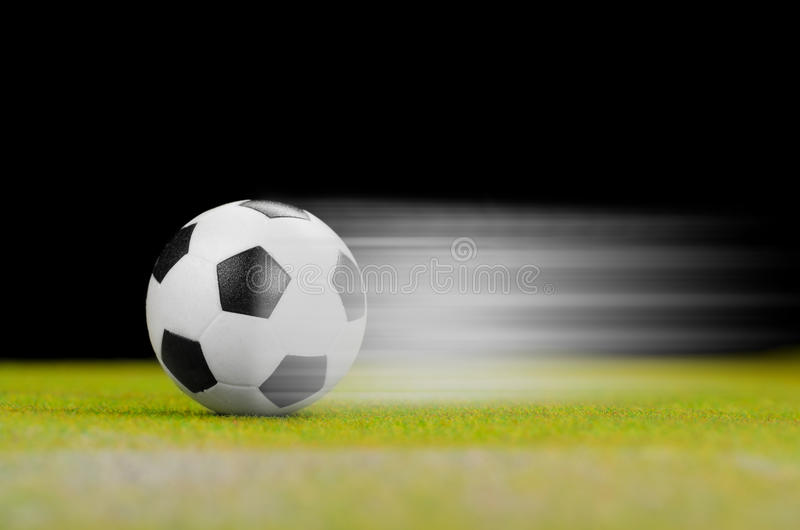 Soccer ball on the green grass. In motion stock image